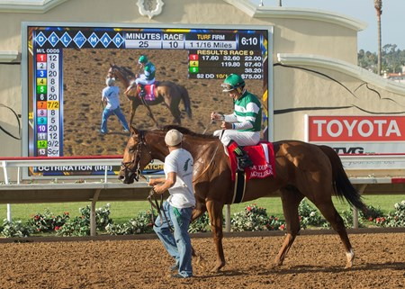 Hronis Racing's Accelerate and jockey Victor Espinoza are guided into the winner's circle after their victory in the G2, $300,000 TVG San Diego Handicap, Saturday, July 22, 2017 at Del Mar Thoroughbred Club, Del Mar CA.