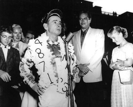 John Longden addresses the crowd in the winner's circle at Del Mar in 1956 after winning the Del Mar Handicap aboard Arrogate