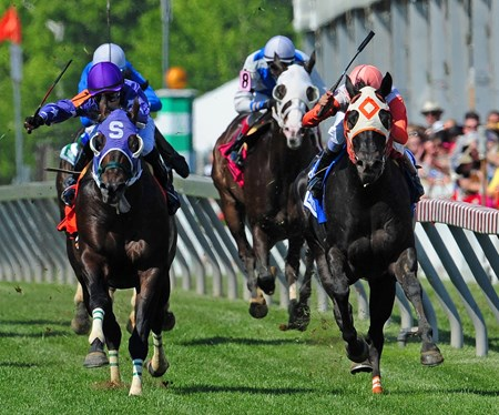 Ben's Cat (inside) Julien Pimentel up, holds off Bold Thunder to win the 10th Running of the Jim McKay Stakes at Pimlico on May 15, 2015.