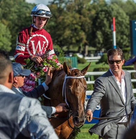 Owner Ron Winchell leads his horse Gun Runner and jockey Forent Geroux to the winner's circle after he won the 90th running of The Whitney Stakes at the Saratoga Race Course  Saturday Aug. 5, 2017 in Saratoga Springs, N.Y.