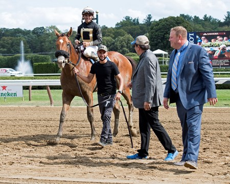 Aveenu Malcainu with Luis Saez wins the 2017 Funny Cide Walkin: r -left, trainer Jeremiah Englehart, owner Al Gold, groom, horse