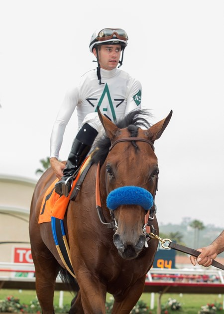 Battle of Midway and jockey Flavien Prat enter the winner's circle after their victory in the $100,000 Shared Belief Stakes, Saturday, August 26, 2017 at Del Mar Thoroughbred Club, Del Mar CA.