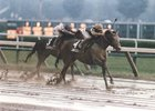 Java Gold, with Pat Day aboard, takes the rain-drenched 1987 Travers Stakes