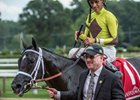 Owner Randy Gullatt leads Pure Silver into winner's circle after the Adirondack Stakes