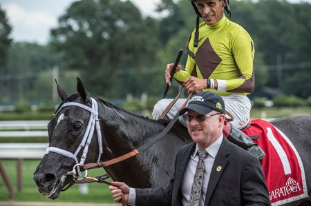 Jockey John Velazquez sits atop Pure Silver as Randy Gulatt, team manager for Twin Creeks Racing lead the pair to the winner's circle after winning the 101st running of The Adirondack at the Saratoga Race  Course Aug. 12, 2017  in Saratoga Springs, N.Y.