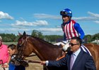 Kaleem Shah leads American Gal and jockey Jose Ortiz into the winner's circle