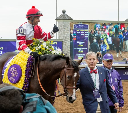 Songbird and jockey Mike Smith win the Breeders' Cup Juvenile Fillies at Keeneland on October 31, 2015. 