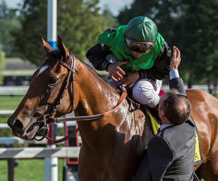 Jockey Javier Castellano is congratulated by trainer Brendan Walsh after winning the 34th running of The Lake Placid aboard Proctor's Ledge Saturday Aug. 19, 2017 at the Saratoga Race Course in Saratoga Springs, N.Y.