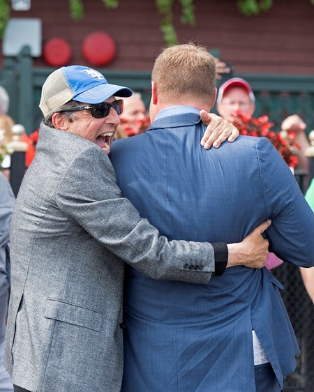 Aveenu Malcainu with Luis Saez wins the 2017 Funny Cide Owner Al Gold, left, hugs trainer Jeremiah Englehart