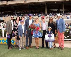 Hunt's connections celebrate their runner's win and automatic berth to the Breeders' Cup Turf