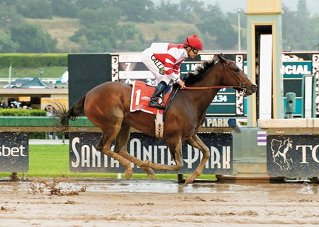 Fox Hill Farms' Songbird and jockey Mike Smith win the Grade I, $400,000 Santa Anita Oaks Saturday, April 9, 2016 at Santa Anita Park, Arcadia, CA.