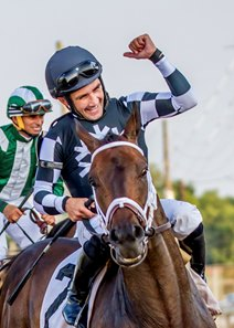 Chris Rosier celebrates winning the Aug. 5 Super Derby Prelude aboard Mr. Misunderstood