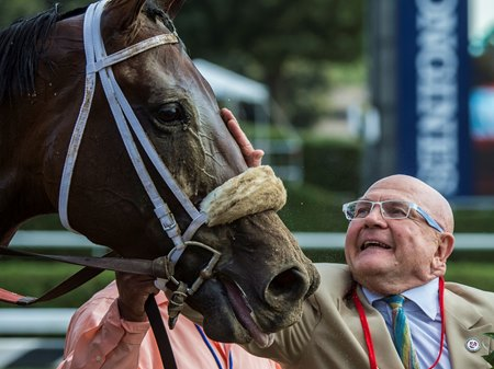 Charles Fipke greets Forever Unbridled after she defeated Songbird in the Personal Ensign Stakes