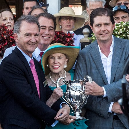 Ron Winchell, right owner of Gun Runner receives the winner's trophy from Mary Lou Whitney with an assist from Chris Kay, CEO of NYRA in the winner's circle after the 90th running of The Whitney Stakes at the Saratoga Race Course  Saturday Aug. 5, 2017 in Saratoga Springs, N.Y.