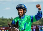 Rajiv Maragh celebrates after winning The Ketel One Ballerina aboard By the Moon this year at Saratoga