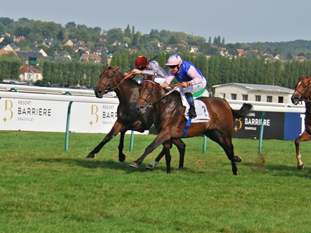 Tiberian nd jockey Olivier Peslier on the nside, winning the  Group 11 Lucien Barrizre Grand Prix de Deauville at Deauville today.
