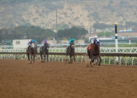 Battle of Midway and jockey Flavien Prat, right, pull away from the field and go on to win the $100,000 Shared Belief Stakes, Saturday, August 26, 2017 at Del Mar Thoroughbred Club, Del Mar CA.