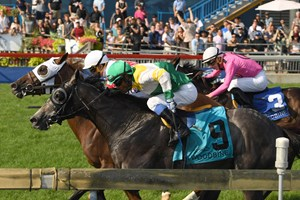 Channel Maker (outside) nosed out Final Copy at the wire to win the Breeders' Stakes at Woodbine