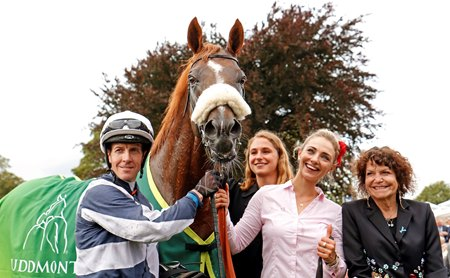 Jockey Jim Crowley, groom Radka Hovadova, and owner Maria Niarchos after the Juddmonte International at York