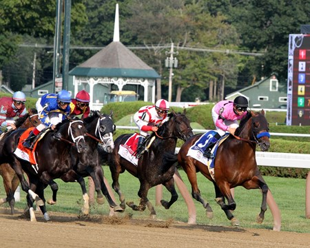 West Coast (#3) with Mike Smith lead the field the first time by and go on to win the 148th Running of the Travers' Stakes at Saratoga on August 26, 2017