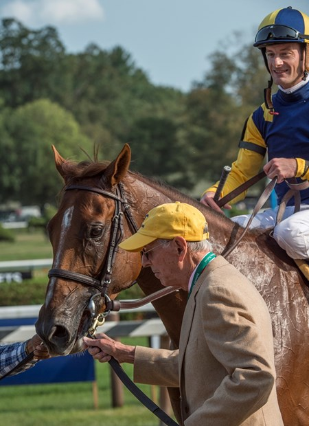 Owner Rene Woolpot leads Sadler's Joy with jockey Julien Leparoux to the winner's circle after the win in the 43rd running of The Sword Dance at the Saratoga Race Course in Saratoga Springs, N.Y.