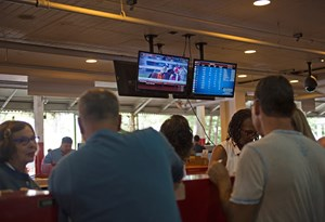 Horseplayers at the betting windows at Saratoga Race Course