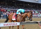 Regular rider Irad Ortiz Jr. kisses Lady Eli after her 2017 Woodford Reserve Ballston Spa Stakes victory at Saratoga Race Course