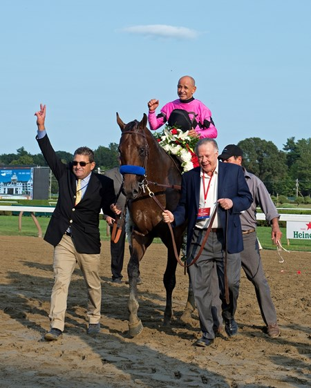 Asst trainer Jimmy Barnes, left, and owner Gary West, right, for walkin. West Coast with Mike Smith wins Travers at Saratoga racecourse in Saratoga Springs, N.Y. on Aug. 26, 2017