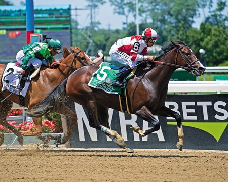 Songbird with Mike Smith wins the Ogden Phipps (G1) at Belmont Park  on June 10, 2017 in Elmont, New York.