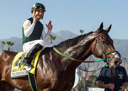 Jockey Corey Nakatani celebrates aboard Bolt d'oro as they enter the winner's circle following their victory in the G1, $300,000 FrontRunner Stakes, Saturday, September 30, 2017 at Santa Anita Park, Arcadia CA.