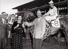 Owner/breeders Daniel and Ada Rice with their 1957 champion older filly Pucker Up. Bill Shoemaker is in the saddle.