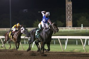 Ricardo Santana Jr. throws a fist in the air as Untrapped crosses the wire first in the Oklahoma Derby