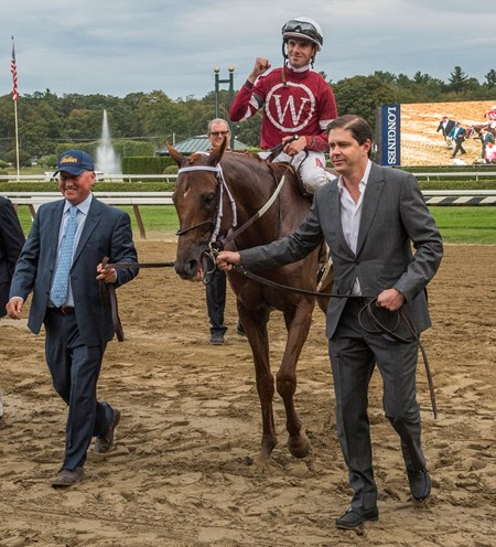 Owner Ron Winchell, right, takes Gun Runner and jockey Florent Geroux to the winner's circle after he win the 64th running of The Woodward presented by NYRA Bets Saturday Sept. 1, 2017 at the Saratoga Race Course in Saratoga Springs, N.Y.
