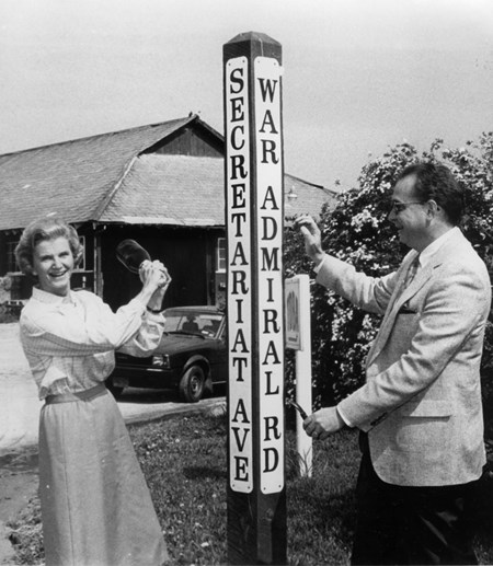 Penny Chenery and NYRA President Gerard J. McKeon prepare to christen the new street sign at the corner of Secretariat Avenue and War Adirmal Road in the backstretch at Belmont Park.