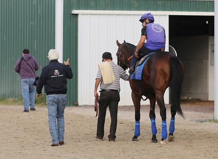 Exercise rider Yeris Ortega receives last minute instructions from trainer Bob Baffert before heading onto the track with West Coast at Parx Racing in Bensalem, Pennsylvania on September 22, 2017.