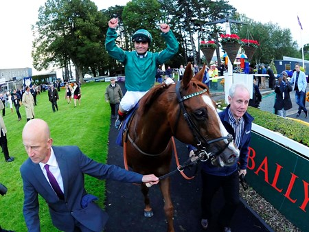 Decorated Knight and Andrea Atzeni after winning the Qipco Irish Champion Stakes for trainer Roger Charlton