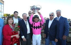 West Coast's connections celebrate his grade 1 victory in the Pennsylvania Derby