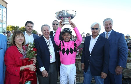 Jockey Mike Smith holds up the Pennsylvania Derby Trophy  with Owners Mary and Gary West (L) and Trainer Bob Baffert after West Coast won the $1,000,000 Grade I Pennsylvania Derby at Parx Racing in Bensalem, Pennsylvania on September 23, 2017
