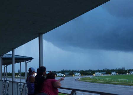 Horsemen kept an eye out for the storm the evening of Sept. 9 at Palm Meadows