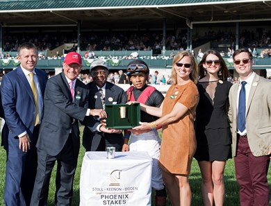 "Trainer Ron Moquett, left, Elias ""Shug"" White, 3rd left, Whitmore with Manuel Franco wins the Stoll Keenon Ogden Phoenix (G2) at Keeneland. Oct. 6, 2017 in Lexington, Kentucky."