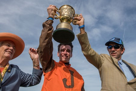 Owner Mrs. S.K. Johnston with her jockey Danny Mullins and trainer Jack Fisher hold the winner's trophy aloft after Mr. Hot Stuff's winning the Grand National Steeplechase race at Far Hills Race Course  Oct. 21, 2017 in Far Hills, N.J.