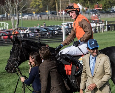 Jockey Danny Mullins is all smiles after Mr. Hot Stuff won the Grand National Steeplechase race at Far Hills Race Course  Oct. 21, 2017 in Far Hills, N.J. Trainer Jack Fisher is lower right.