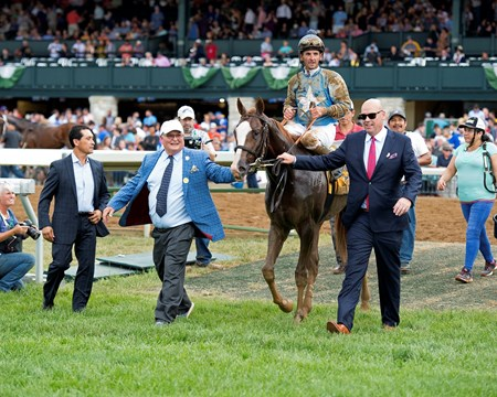 Owners Dennis Albaugh and Jason Loutsch (right) lead in horse. Free Drop Billy with Robby Albarado up wins the Claiborne Breeders' Futurity (G1) at Keeneland on Oct. 7, 2017 in Lexington, Kentucky.