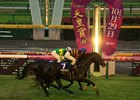 Kitasan Black narrowly scores over Satono Crown on the soft turf in the rain at Tokyo
