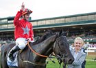 Daniel Tudhope celebrates aboard Suedois after winning the Shadwell Turf Mile at Keeneland