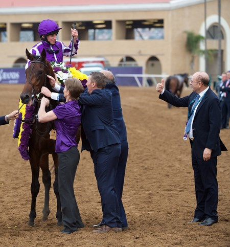 Ryan Moore celebrates winning the Breeders Cup Juvenile Turf atop Mendelssohn on November 3, 2017.