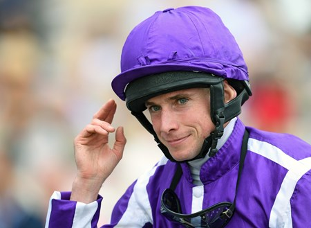 Jockey Ryan Moore gives his traditional salute, after winning the Breeders' Cup Juvenile Turf on Mendelssohn