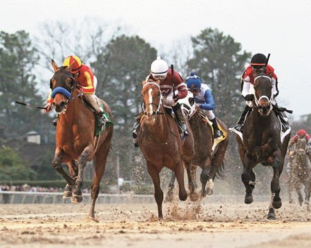 Hoppertunity (left) outfinishes Tapiture (middle) and Ride On Curlin to win the Rebel Stakes.