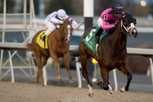 Win the War surges ahead of Grace and Dignity to win the Glorious Song Stakes in the Woodbine stretch
