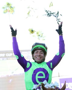 Jose Ortiz celebrates after winning Breeders' Cup Juvenile on Good Magic